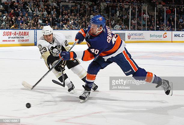 Michael Grabner of the New York Islanders shoots the puck against Ryan Craig of the Pittsburgh Penguins on February 11 2011 at Nassau Coliseum in...
