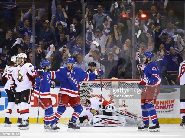 Michael Grabner of the New York Rangers celebrates his firstperiod goal against Craig Anderson of the Ottawa Senators and is joined by Mats...