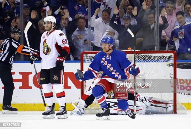 Michael Grabner of the New York Rangers celebrates his firstperiod goal against Craig Anderson of the Ottawa Senators in Game Three of the Eastern...