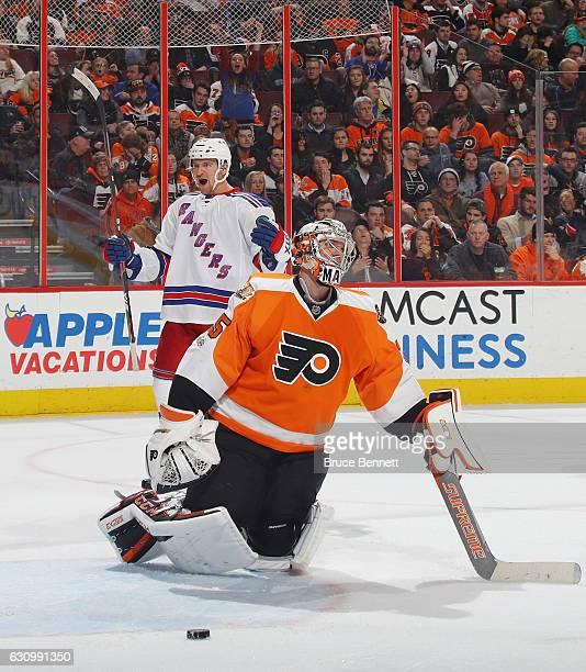 Michael Grabner of the New York Rangers celebrates his third period goal against Steve Mason of the Philadelphia Flyers at the Wells Fargo Center on...
