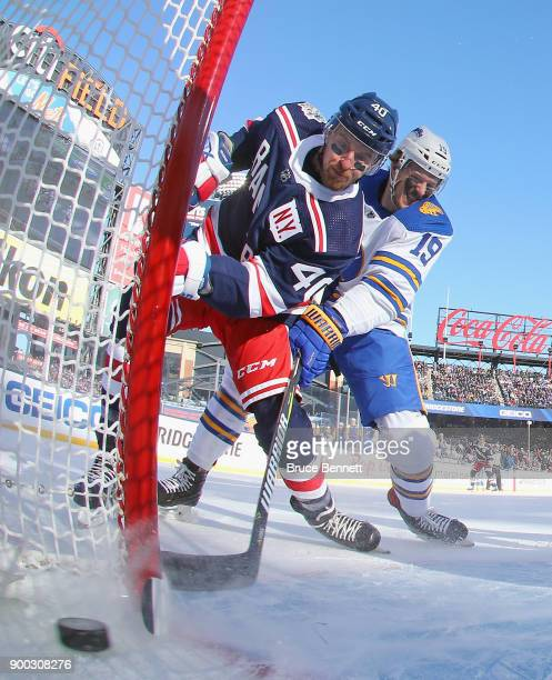 Michael Grabner of the New York Rangers scores a first period goal against the Buffalo Sabres during the 2018 Bridgestone NHL Winter Classic at Citi...