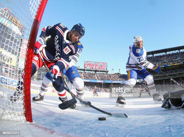 Michael Grabner of the New York Rangers scores a firstperiod goal against the Buffalo Sabres during the 2018 Bridgestone NHL Winter Classic at Citi...