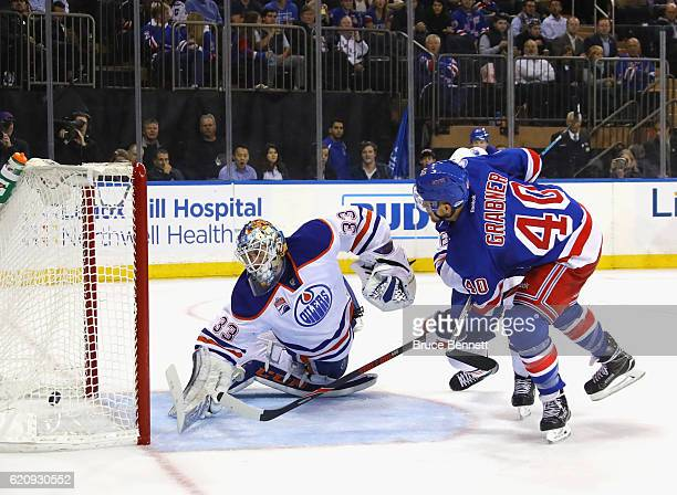 Michael Grabner of the New York Rangers scores at 1546 of the second period against Cam Talbot of the Edmonton Oilers at Madison Square Garden on...