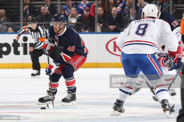 Michael Grabner of the New York Rangers skates with the puck against Greg Pateryn of the Montreal Canadiens at Madison Square Garden on February 21...