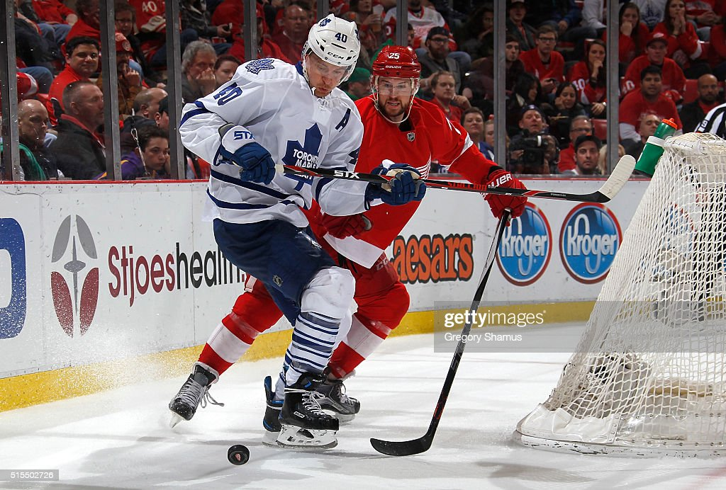 Michael Grabner #40 of the Toronto Maple Leafs tries to control the puck in front of Mike Green #25 of the Detroit Red Wings during the third period at Joe Louis Arena on March 13, 2016 in Detroit, Michigan. Toronto won the game 1-0.