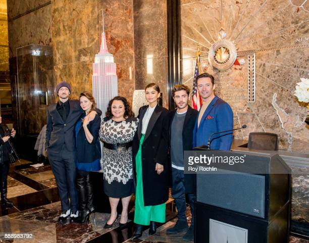 Michael Gracey Rebecca Ferguson Keala Settle Zendaya Zac Efron and Hugh Jackman attend the cast of 'The Greatest Showman' light the Empire State...