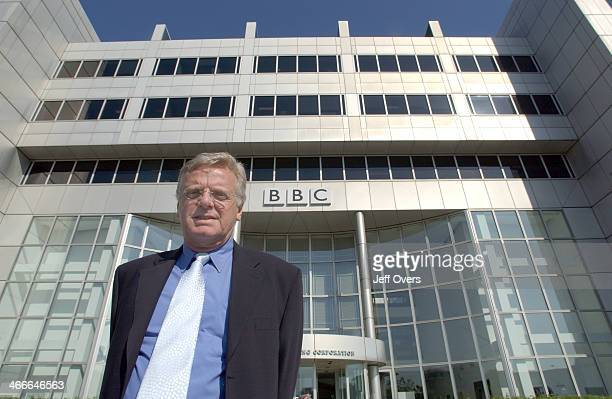 Michael Grade stands in front of the BBC White City building with the BBC logo visible behind him on his first morning as the Chairman of the BBC
