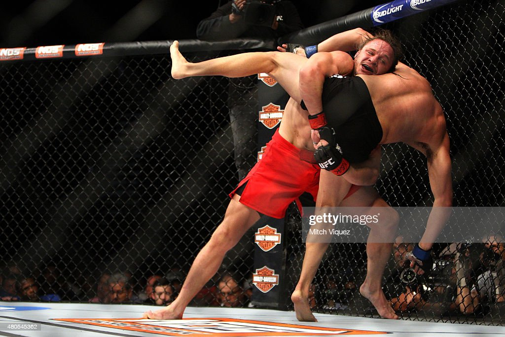 Michael Graves attempts to take down Vicente Luque in their welterweight bout during the Ultimate Fighter Finale inside MGM Grand Garden Arena on July 12, 2015 in Las Vegas, Nevada.