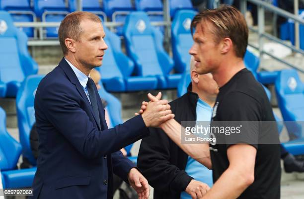 Michael Gravgaard CEO of Randers FC shakes hands with Marvin Pourie of Randers FC prior to the Danish Alka Superliga match between Randers FC and OB...