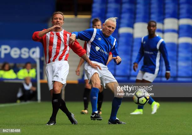 Michael Gray and Peter Reid battle for the ball during the Bradley Lowery charity match at Goodison Park Liverpool