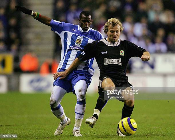Michael Gray of Blackburn Rovers holds back Henri Camara of Wigan Athletic during the Barclays Premiership match between Wigan Athletic and Blackburn...
