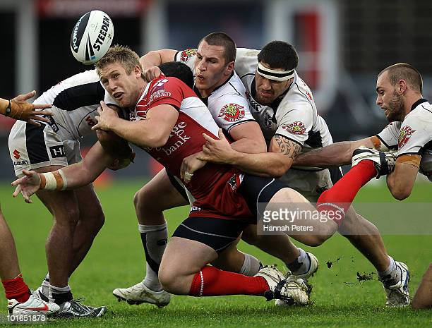 Michael Greenfield of the Dragons offloads the ball during the round 13 NRL match between the Warriors and the St George Illawarra Dragons at Mt...