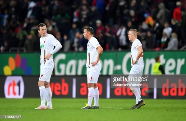 Michael Gregoritsch Julian Schieber and Andre Hahn of Augsburg look dejected in defeat after the Bundesliga match between FC Augsburg and Bayer 04...