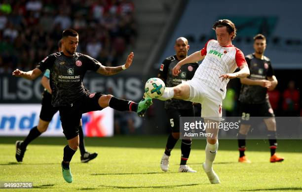 Michael Gregoritsch of Augsburg and Danny Latza of Mainz battle for the ball during the Bundesliga match between FC Augsburg and 1 FSV Mainz 05 at...