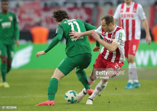 Michael Gregoritsch of Augsburg and Matthias Lehmann of Koeln battle for the ball during the Bundesliga match between 1 FC Koeln and FC Augsburg at...