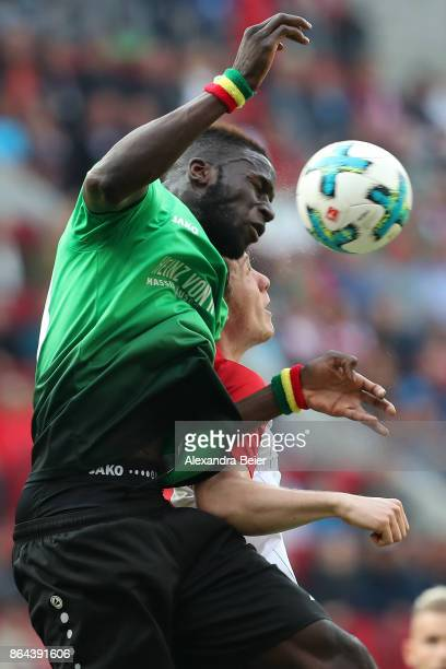 Michael Gregoritsch of Augsburg and Salif Sane of Hannover fight for the ball during the Bundesliga match between FC Augsburg and Hannover 96 at...