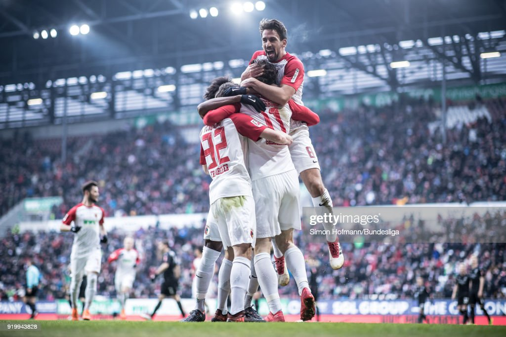 Image has been digitally enhanced.) Michael Gregoritsch of Augsburg celebrates a disallowed goal with his team mates during the Bundesliga match between FC Augsburg and VfB Stuttgart at WWK-Arena on February 18, 2018 in Augsburg, Germany.