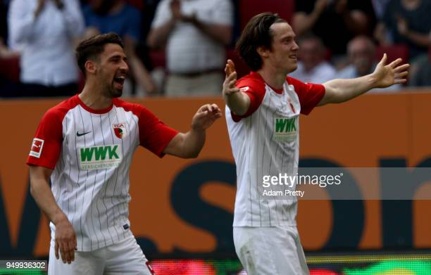 Michael Gregoritsch of Augsburg celebrates after he scores the opening goal during the Bundesliga match between FC Augsburg and 1 FSV Mainz 05 at...
