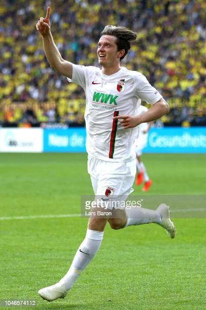 Michael Gregoritsch of Augsburg celebrates after scoring his team's third goal during the Bundesliga match between Borussia Dortmund and FC Augsburg...
