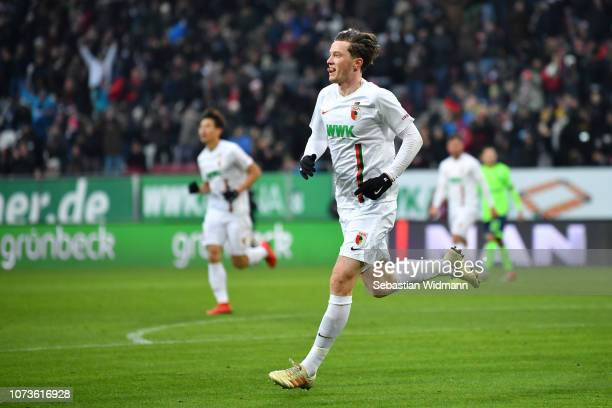 Michael Gregoritsch of Augsburg celebrates after scoring his team's first goal during the Bundesliga match between FC Augsburg and FC Schalke 04 at...
