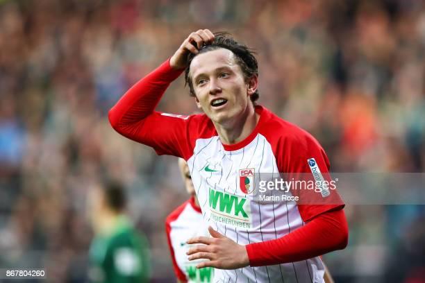 Michael Gregoritsch of Augsburg celebrates after scoring his team's first goal to make it 0-1 during the Bundesliga match between SV Werder Bremen...