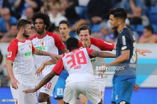 Michael Gregoritsch of Augsburg celebrates his goal to make it 11 with Caiuby of Augsburg during the Bundesliga match between TSG 1899 Hoffenheim and...