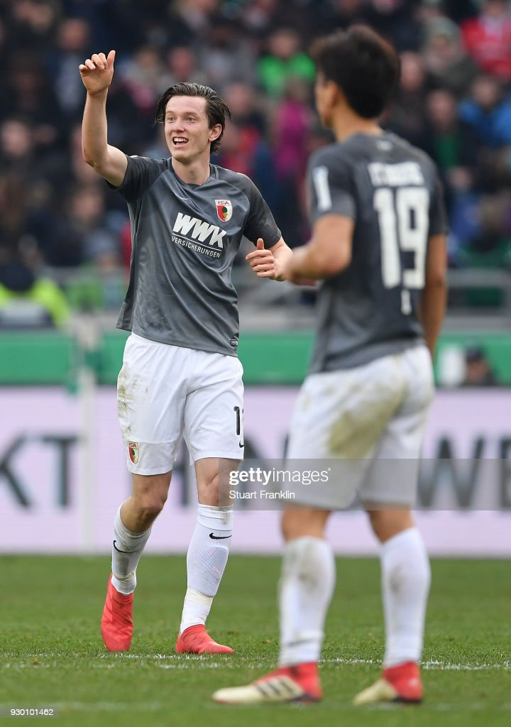 Michael Gregoritsch of Augsburg celebrates scoring his second goal during the Bundesliga match between Hannover 96 and FC Augsburg at HDI-Arena on March 10, 2018 in Hanover, Germany.