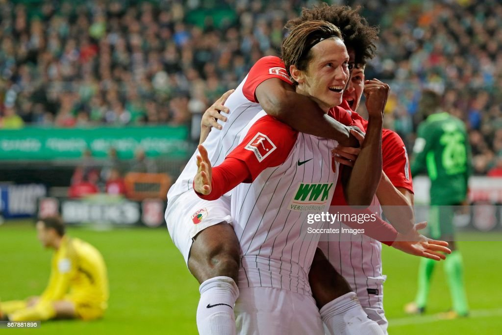 Michael Gregoritsch of Augsburg celebrates with Caiiuby of Augsburg during the German Bundesliga match between Werder Bremen v FC Augsburg at the Weser Stadium on October 29, 2017 in Bremen Germany