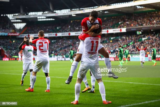 Michael Gregoritsch of Augsburg celebrates with Rani Khedira after scoring his team's first goal to make it 01 during the Bundesliga match between SV...