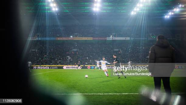 Michael Gregoritsch of Augsburg challenges for the ball with Oscar Wendt of Mönchengladbach during the Bundesliga match between Borussia...