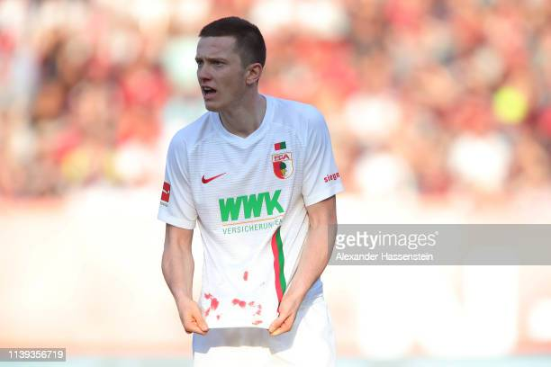 Michael Gregoritsch of Augsburg holds his match jersey during the Bundesliga match between 1. FC Nuernberg and FC Augsburg at Max-Morlock-Stadion on...
