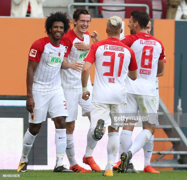 Michael Gregoritsch of Augsburg ist celebrated by his team mates after he scored a goal to make it 10 for Augsburg during the Bundesliga match...