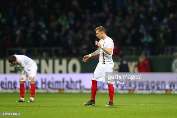 Michael Gregoritsch of Augsburg reacts with team mate Andre Hahn after the Bundesliga match between SV Werder Bremen and FC Augsburg at Weserstadion...