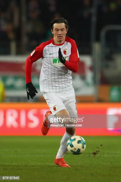 Michael Gregoritsch of Augsburg runs with the ball during the Bundesliga match between FC Augsburg and VfL Wolfsburg at WWKArena on November 25 2017...