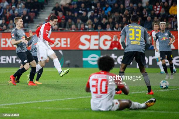 Michael Gregoritsch of Augsburg scores his teams first goal to make it 1:0 during the Bundesliga match between FC Augsburg and RB Leipzig at...