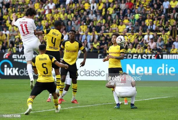 Michael Gregoritsch of Augsburg scores his team's third goal during the Bundesliga match between Borussia Dortmund and FC Augsburg at Signal Iduna...