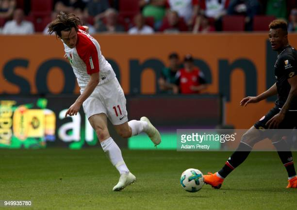 Michael Gregoritsch of Augsburg scores the opening goal during the Bundesliga match between FC Augsburg and 1 FSV Mainz 05 at WWKArena on April 22...