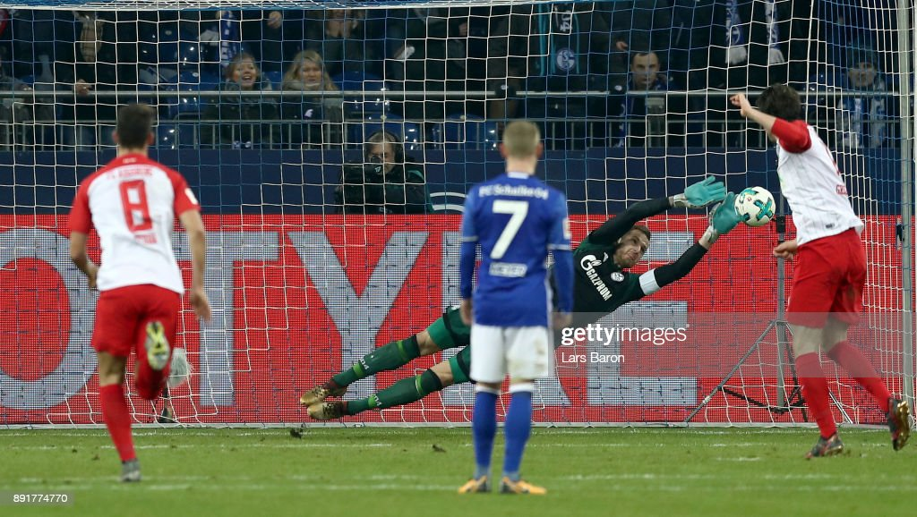 Michael Gregoritsch of Augsburg shoots apenalty on goal during the Bundesliga match between FC Schalke 04 and FC Augsburg at Veltins-Arena on December 13, 2017 in Gelsenkirchen, Germany.