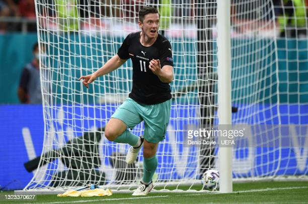 Michael Gregoritsch of Austria celebrates after scoring their side's second goal during the UEFA Euro 2020 Championship Group C match between Austria...