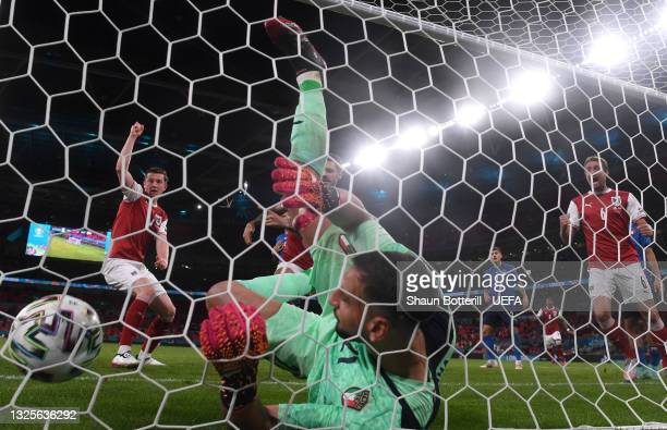 Michael Gregoritsch of Austria celebrates after their side's first goal scored by Sasa Kalajdzic as Gianluigi Donnarumma of Italy falls into the net...
