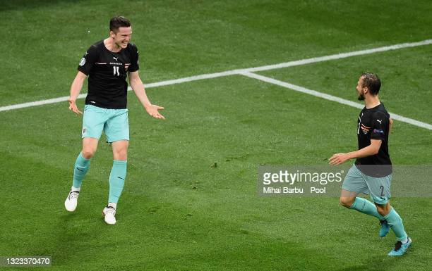 Michael Gregoritsch of Austria celebrates with Andreas Ulmer after scoring their side's second goal during the UEFA Euro 2020 Championship Group C...