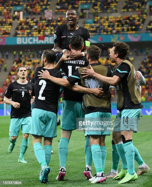 Michael Gregoritsch of Austria celebrates with David Alaba and team mates after scoring their side's second goal durng the UEFA Euro 2020...