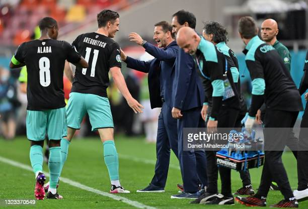Michael Gregoritsch of Austria celebrates with Franco Foda, Head Coach of Austria after scoring their side's second goal during the UEFA Euro 2020...