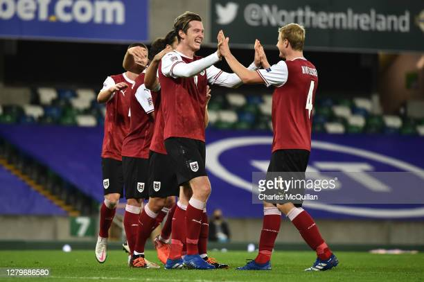 Michael Gregoritsch of Austria celebrates with his team after scoring his team's first goal during the UEFA Nations League group stage match between...