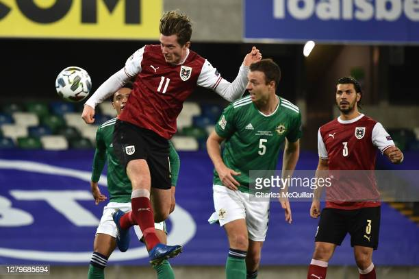 Michael Gregoritsch of Austria scores his team's first goal during the UEFA Nations League group stage match between Northern Ireland and Austria at...