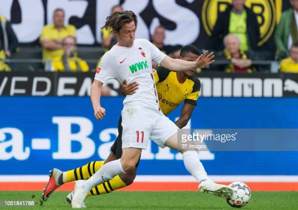 Michael Gregoritsch of FC Augsburg and Manuel Akanji of Borussia Dortmund battle for the ball during the Bundesliga match between Borussia Dortmund...