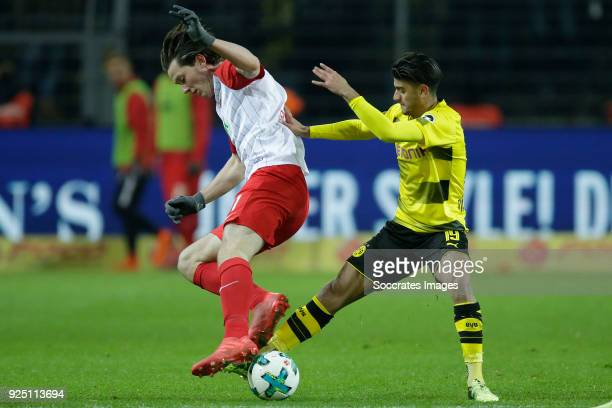 Michael Gregoritsch of FC Augsburg Mahmoud Dahoud of Borussia Dortmund during the German Bundesliga match between Borussia Dortmund v FC Augsburg at...