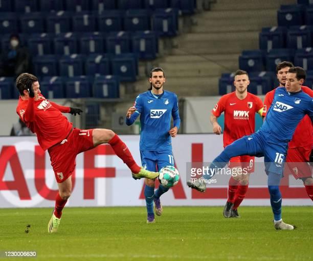 Michael Gregoritsch of FC Augsburg, Sebastian Rudy of TSG 1899 Hoffenheim during the Bundesliga match between TSG Hoffenheim and FC Augsburg at...