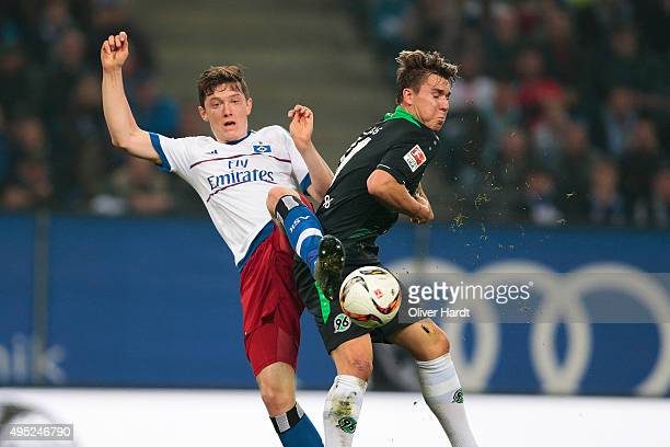Michael Gregoritsch of Hamburg and Felix Klaus of Hannover compete for the ball during the First Bundesliga match between Hamburger SV and Hannover...