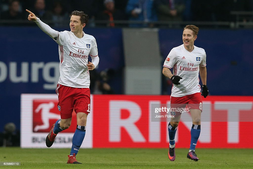 Michael Gregoritsch of Hamburg celebrates after scoring his team's first goal of Hamburg and x of Bremen compete for the ball during the Bundesliga match between Hamburger SV and Werder Bremen at Volksparkstadion on November 26, 2016 in Hamburg, Germany.